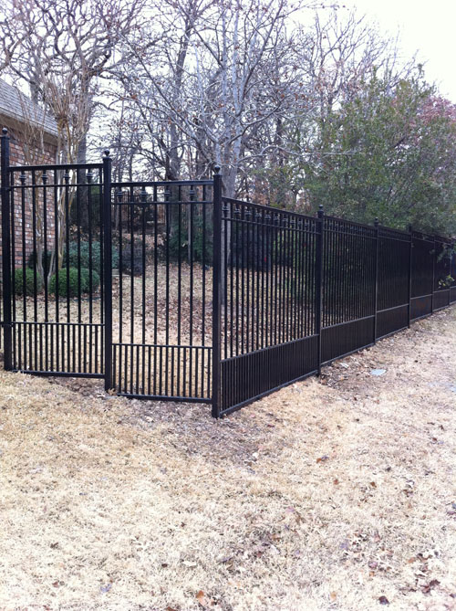 Wrought iron fence with wood or composite privacy